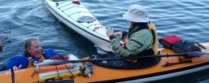 Two paddlers practicing rescues at skills night at the Campbell River Estuary
