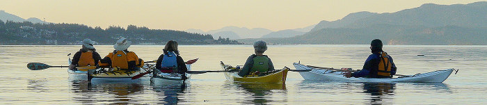 Members on a paddle taking a moment to enjoy the view of the channel between Campbell River and Quadra Island.